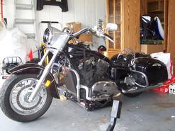 the vulcan classic 1500 front-end installed and test fit of the h-d  headlight nacelle  i first tried the headlight nacelle over the top  triple-tree clamp,